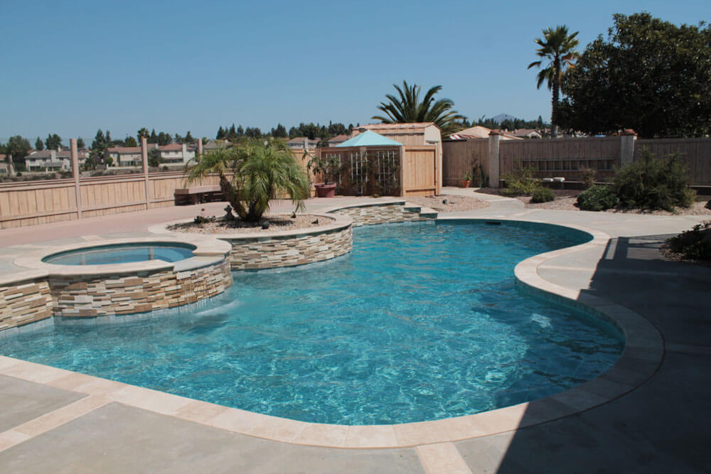 Freeform-Pool-with-Raised-Spa-After-Renovation