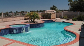 Freeform-Pool-with-Raised-Spa-Before-Renovation