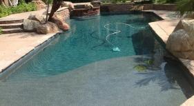 Custom-Pool-with-Tanning-Ledge-and-Raised-Spa