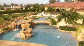 Custom Freeform Pool with Beach Entry, Bridge, & Waterfall