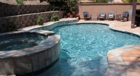 Freeform-Pool-with-Raised-Spa-and-French-Grey-Finish-min