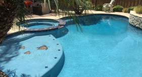 Freeform Pool and Spa with Bright Blue Finish