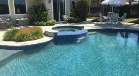 Freeform Pool with Raised Tiled Overflow Spa