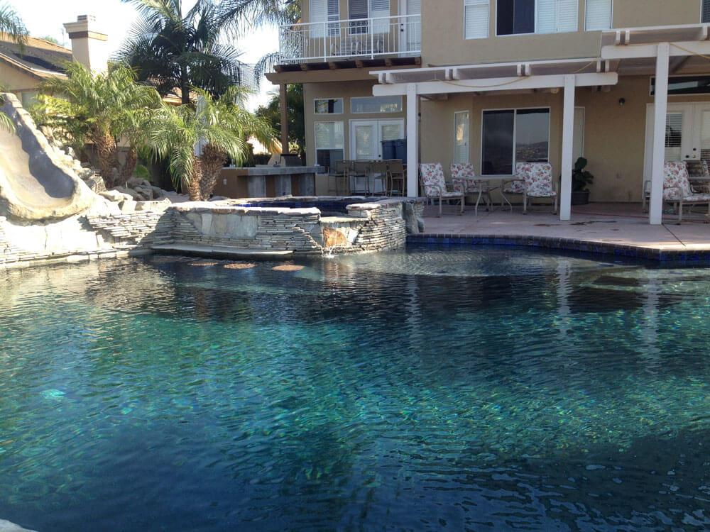 Freeform Pool with Raised Spa, Tanning Ledge, and Swim Up Bar